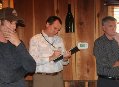 Caltrans engineer Steve McDonald (center) took notes on residents' concerns. Photo by John Chadwell.