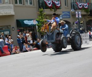 "Pat Ricotti and Elliott French showcasing their ""bucking tractor"" during the 2018 Downtown Parade. Photo by Blaire Strohn."