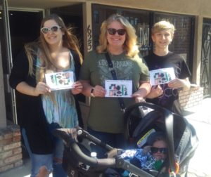 "Marni Bishop (center) and her family participated in the March 16 scavenger hunt. On top of creating a competition to see who could find the hidden items in the shortest amount of time, Bishop stated, ""I'm buying all kinds of stuff."" Photo by Becky Bonner."