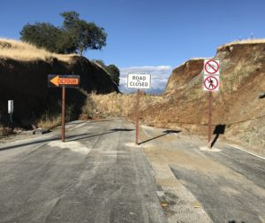 Temporary signs block the collapsed reroute on State Route 25 in south San Benito County. File photo.