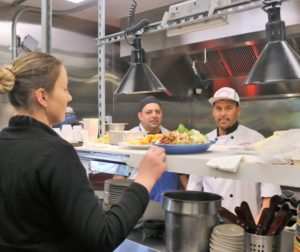 Husband and wife restaurant entrepreneurs Kaley Arie and Lupe Farias (right) work hard every day to make their business a success. Photo by John Chadwell.