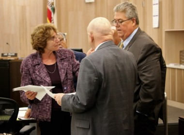 DA Candice Hooper confers with defense attorneys Harry Damkar and Greg LaForge. Photo by John Chadwell.