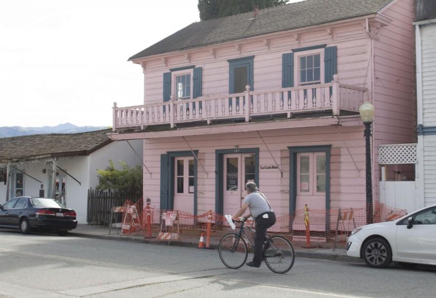 A cyclist rides past La Casa Rosa in San Juan Bautista. File photo by Noe Magaña.