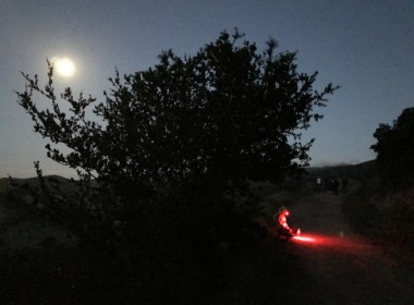 Walkers use red flashlights as they walk home. Photo by Leslie David.
