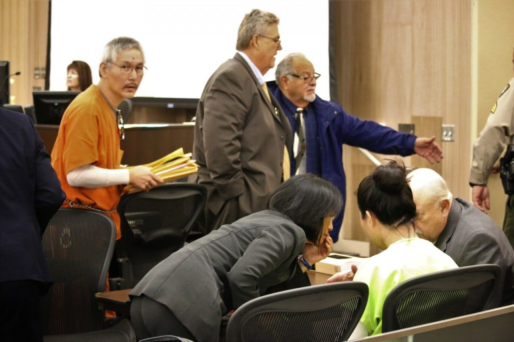 Sang Ji walks into the courtroom during a March hearing as Jung Choi confers with defense attorney Harry Damkar through her Korean interpreter. Photos by John Chadwell.