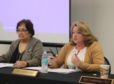 Board member Jeri Hernandez (right) made the motion to stay with ACE. Photo by John Chadwell.