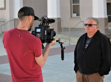 Holt being interviewed for a video to promote the upcoming motorcycle rally in July.