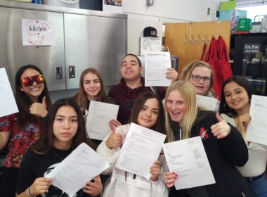 SBHS students in Fisher's class proudly hold up the resumes they have made. Photo by Becky Bonner.