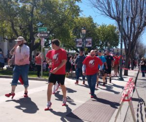Walkers head out from the Veterans Memorial Building in downtown Hollister during the 2019 Walk a Mile in Her Shoes event on April 13. Photos by Carmel de Bertaut.