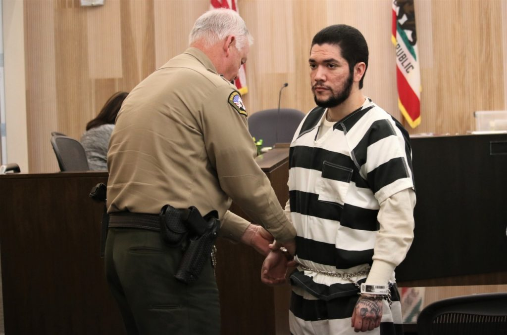 Jose Antonio Barajas stands at an April 15 hearing at San Benito County Superior Court. He will be tried for premeditated, first degree murder, attempted murder, kidnapping and other charges. Photo by John Chadwell.