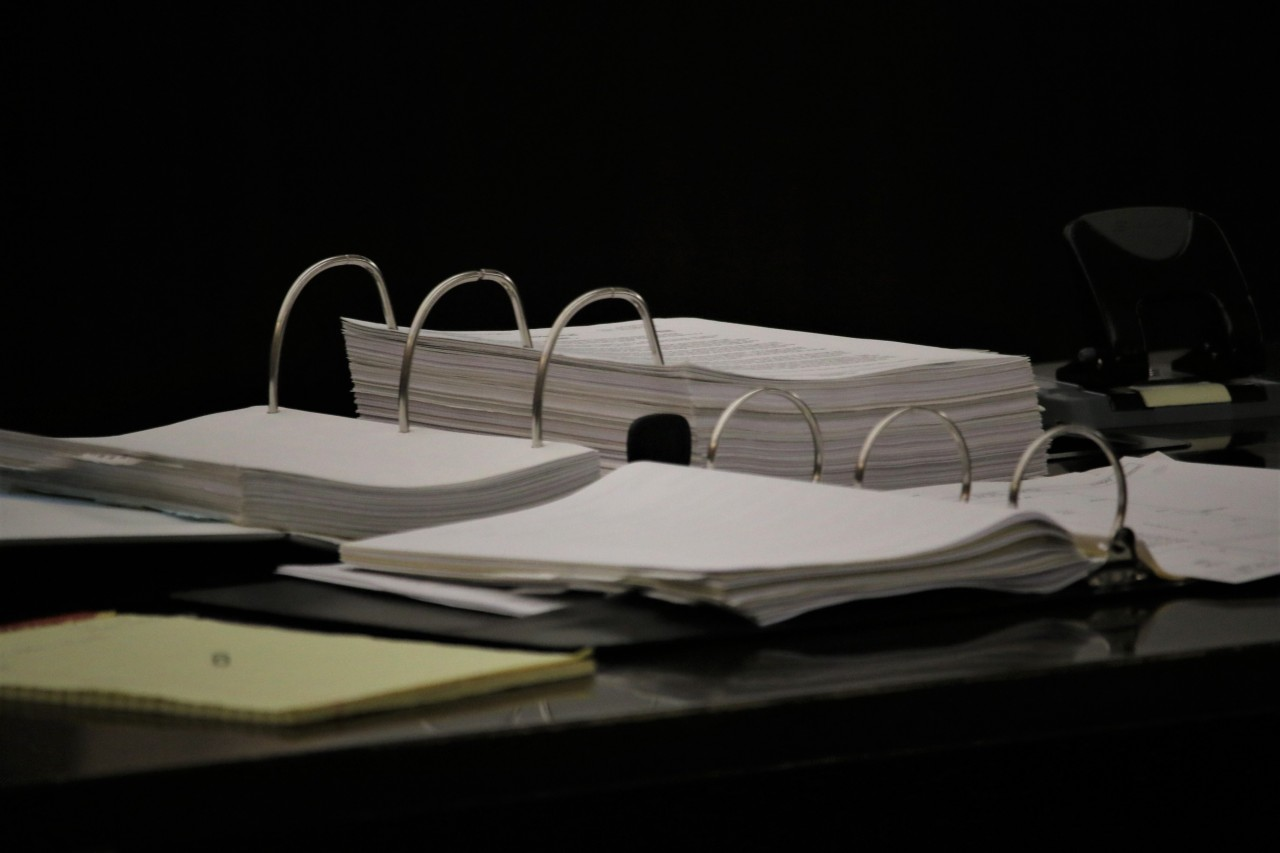 The DA had five years to build the case against Barajas. Hooper referred to these documents throughout the hearing. Photo by John Chadwell.