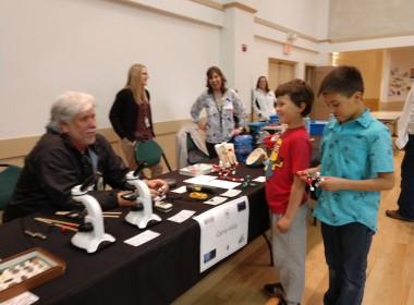 Levi and Luke Garenas talk with fifth grade science teacher Ken Johnson. Photo by Carmel de Bertaut.