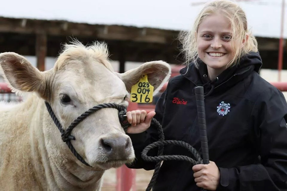 This picture with the steer is from my freshman year at Fresno State. I was actively involved in Fresno State Beef Cattle Show Team where we competed at collegiate jackpot shows throughout the state of California. Photo courtesy of Blaire Strohn.