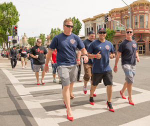 Members of the Hollister Fire Department crossing Fifth Street along San Benito on April 22, 2017 for the annual Walk a Mile in Her Shoes event. Photos by Lisa Robinson-Ward.