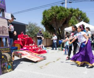 Delana Lozano, 9, playing bean bag toss at the April 28 El Teatro Campesino Family Day fundraiser. Photo by Noe Magaña.