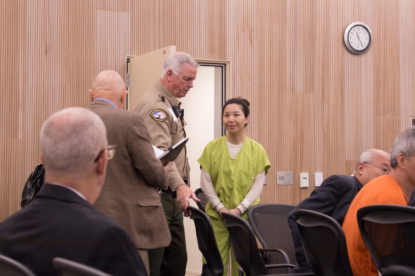 Jung Choi greets her translator before taking a seat during a May 1 hearing at San Benito County Superior Court. Photo by Noe Magaña.