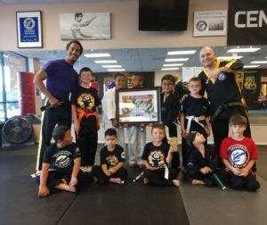 Angelo Hudson and Mark Preader with students at Enterprise Academy of Martial Arts in Hollister. Photo by Carmel de Bertaut.