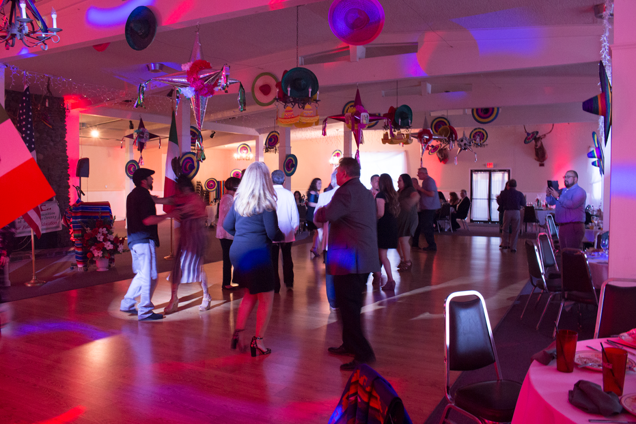 Attendees danced to popular artists like Ramon Ayala and Selena at the Elks Lodge. Photo by Noe Magaña.