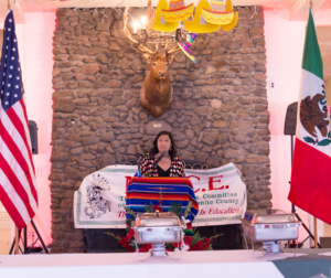 MACE President Veronica Lezama addresses attendees at the May 4 fundraiser. Photo by Noe Magaña.