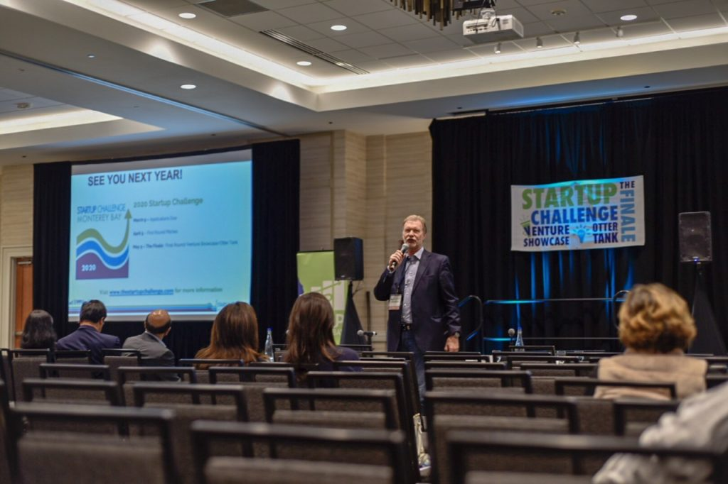 Brad Barbeau, executive director of the Institute for Innovation & Economic Development, addresses the crowd the 2019 Startup Challenge. Photo by Matt Koller.