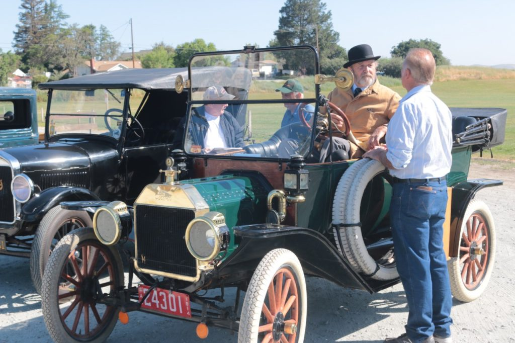 Motorists chat in the parking lot of San Juan School before heading out for the first annual Jim West Antique Auto Tour on May 11. The antique car ride took place on the Juan Bautista de Anza Historic Trail. Photos by John Chadwell.