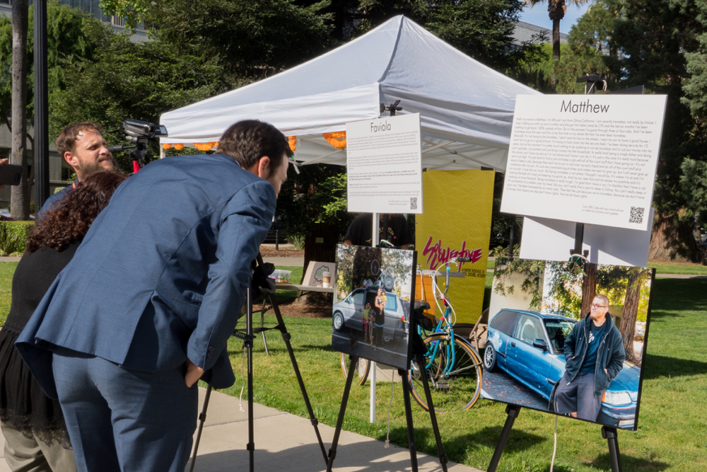 Ben Allen, a senator representing the 26th District in southern California, reads about homeless individuals and families. Photo provided by Kirti Bassendine.