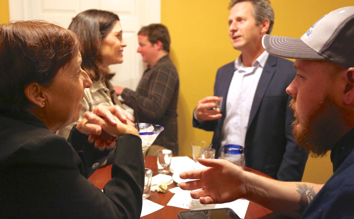 BenitoLink Reporter Carmel de Bertaut talks to guest Evan Buscher. Photo by Leslie David.