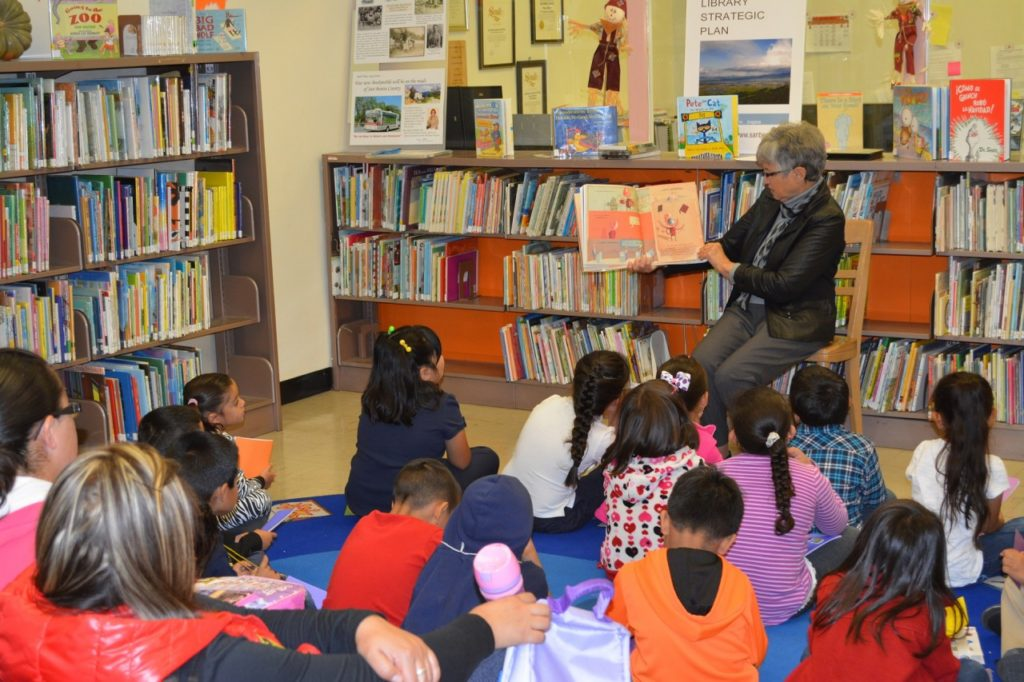Children being read to during story time at the San Benito County Free Library. File photo.