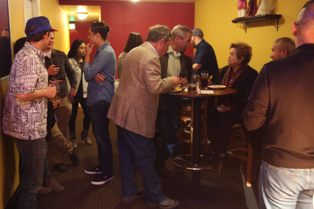 Guests enjoying food and drinks at the May 16 BenitoLink Spring Fiesta and Tequila Tasting. Photo by Leslie David