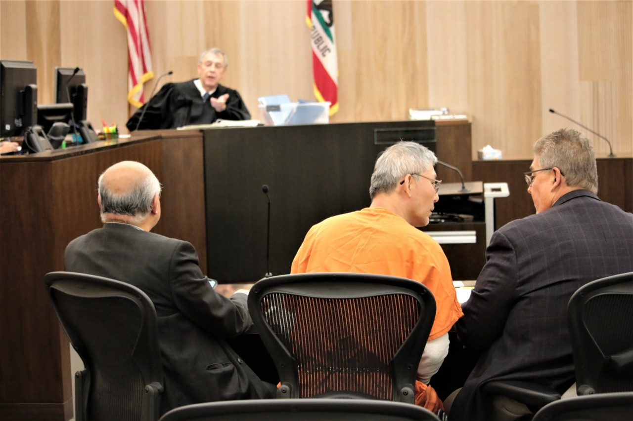 Sang Ji talks with his defense attorney Gregory LaForge (right).