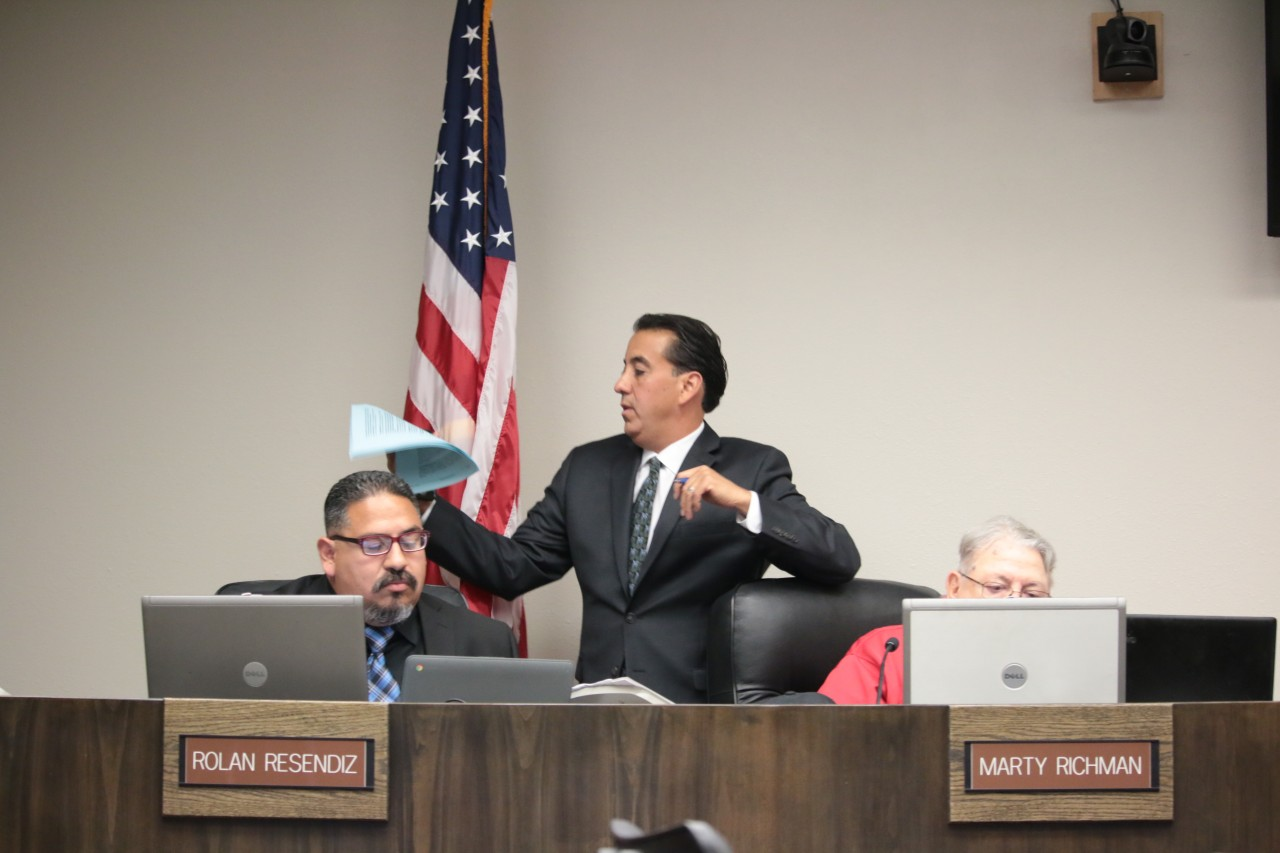 As Mayor Ignacio Velazquez left the council chambers after recusing himself, Councilman Marty Richman stopped him. He told the mayor that he must state what his conflict of interest was and give the address of the building in question.