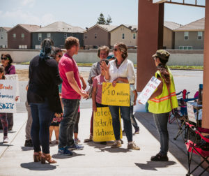 Protesters speak with onlookers outside of the San Benito County Public Health Services office during a May 31 protest. Photos by Heather Graham.