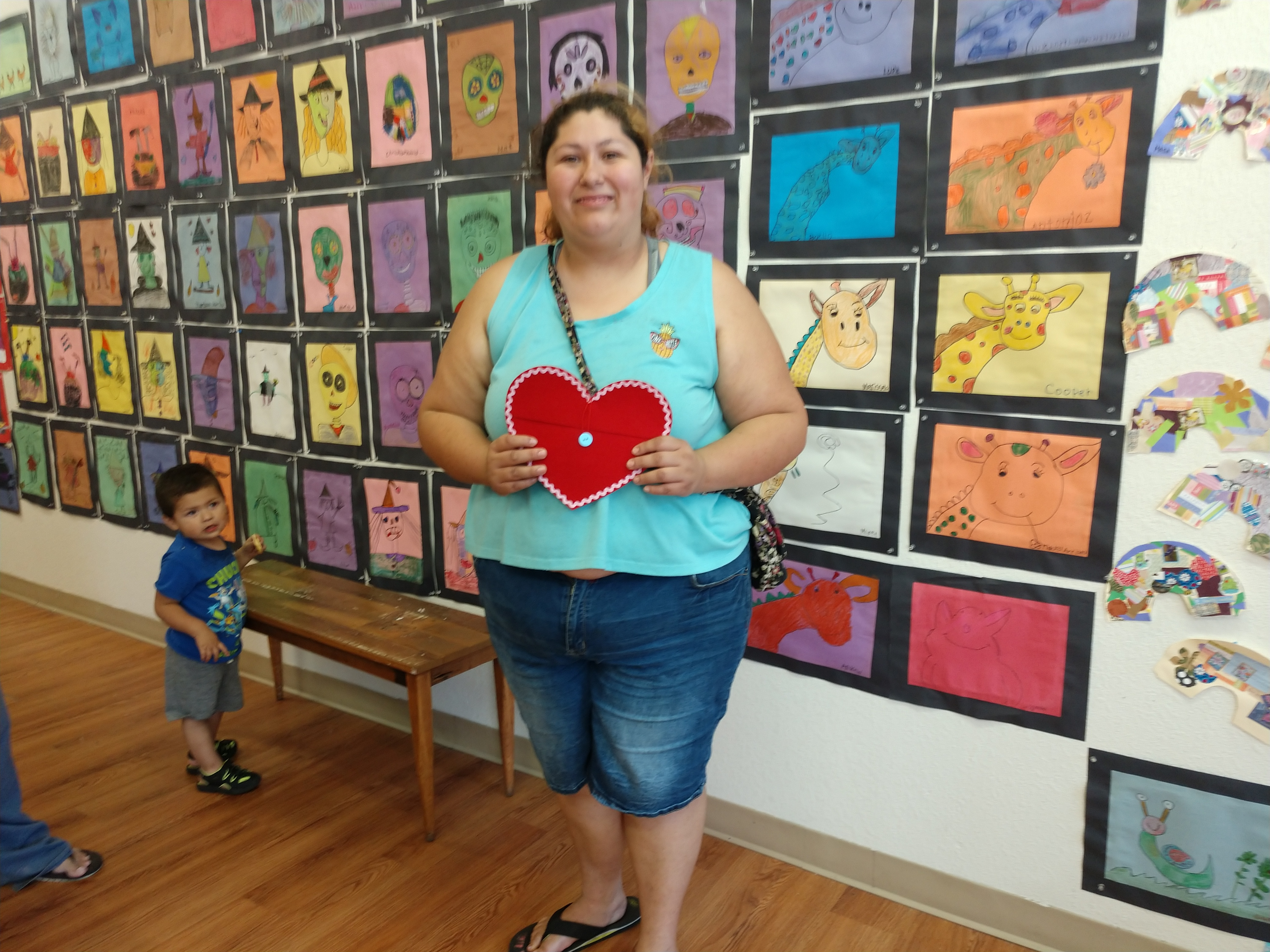 Lupe's certificate is heart-shaped because almost all of her artwork has hearts in it.