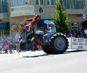 Derek Lacasa and Pat Ricotti entertain the crowd on their bucking tractor. Photo by Blaire Strohn.