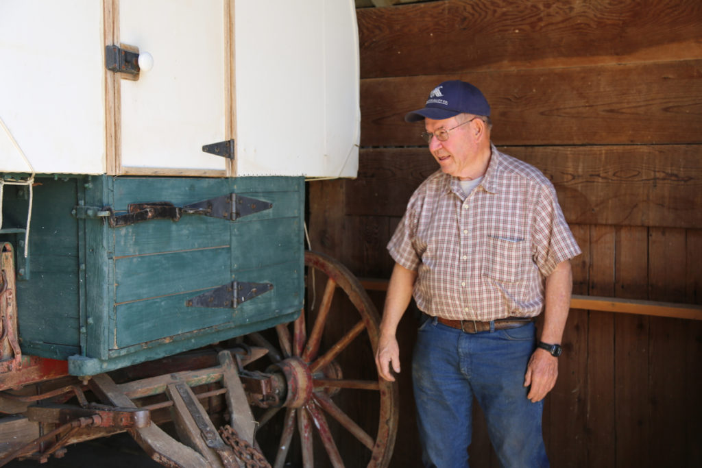 Dave Wright looks over the wagon, assessing the project before taking it on. Photo by Leslie David.