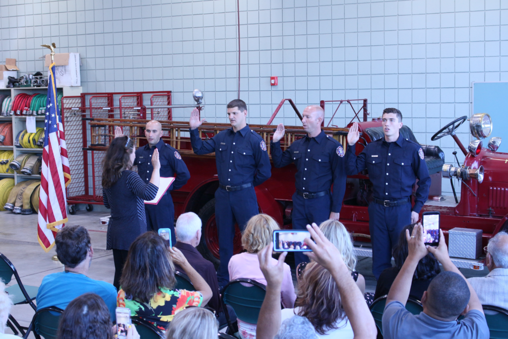 City Clerk Christine Black swears in new firefighters. Photo by Noe Magaña.