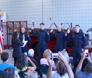 City Clerk Christine Black swears in new firefighters. Photo by Noe Magaña.