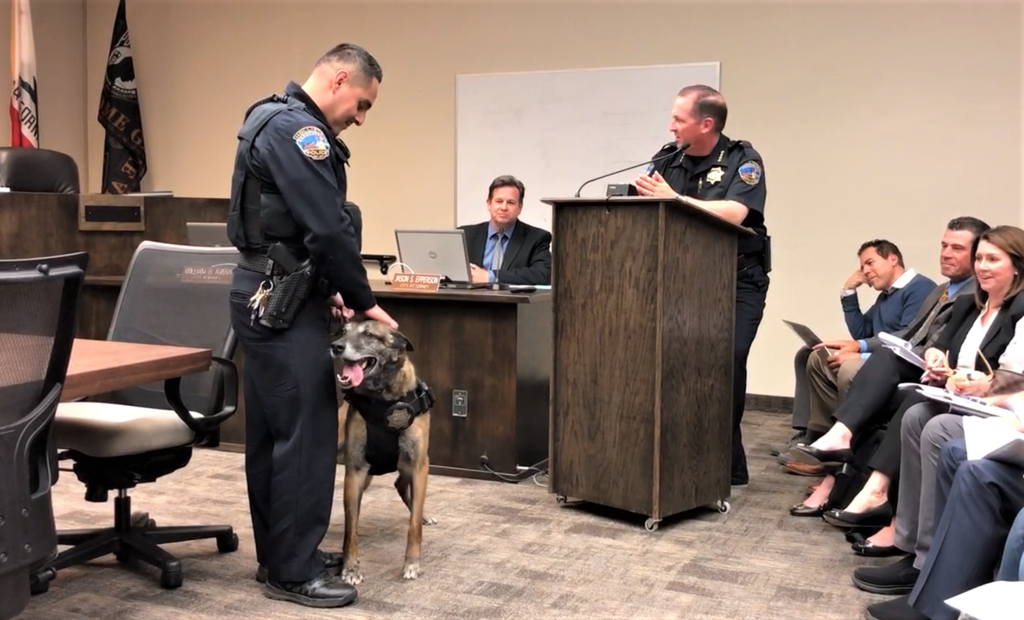 Officer Melgoza stands with K-9 Freeze while Police Chief David Westrick speaks. Photos by John Chadwell.