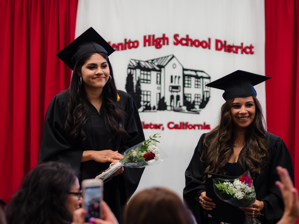 Sabrina Ippolito and fellow graduate Quixcia Guzman pose for photos.