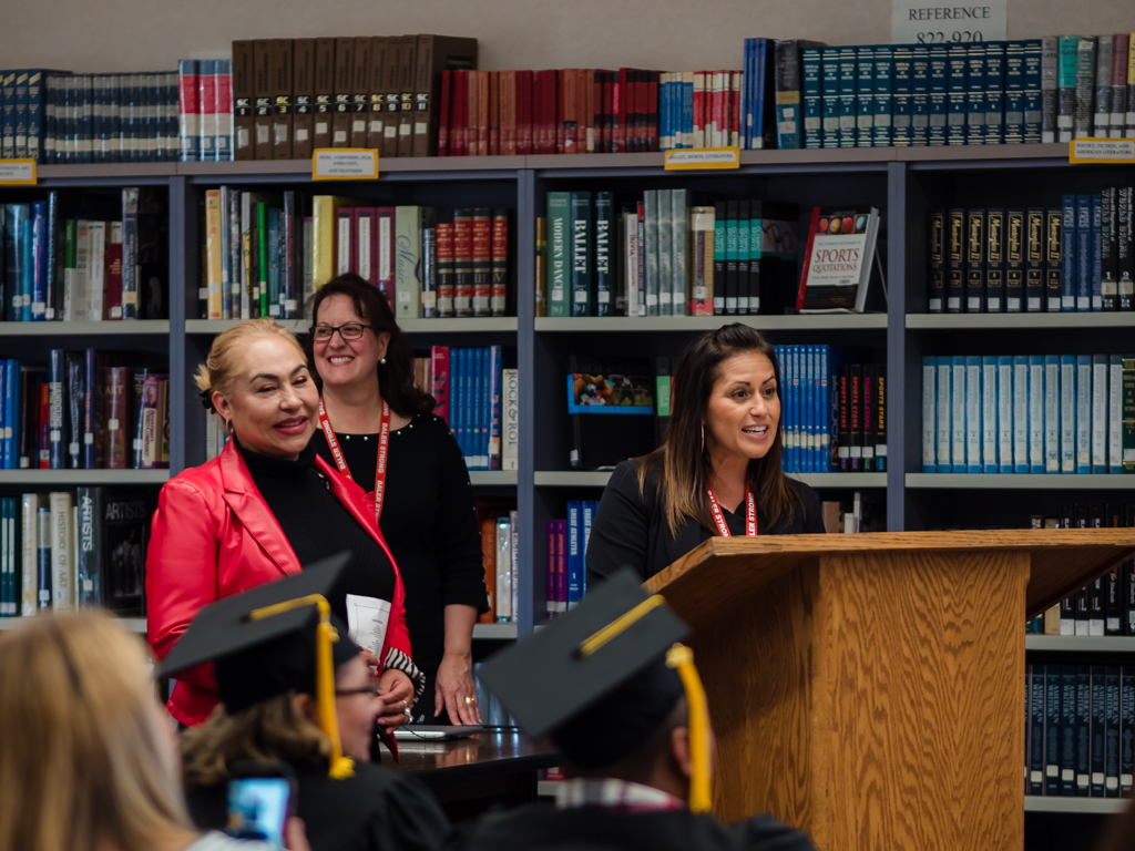 Elaine Klauer, Rafaela Espinoza, and Sharon Finley welcome graduates and their families.