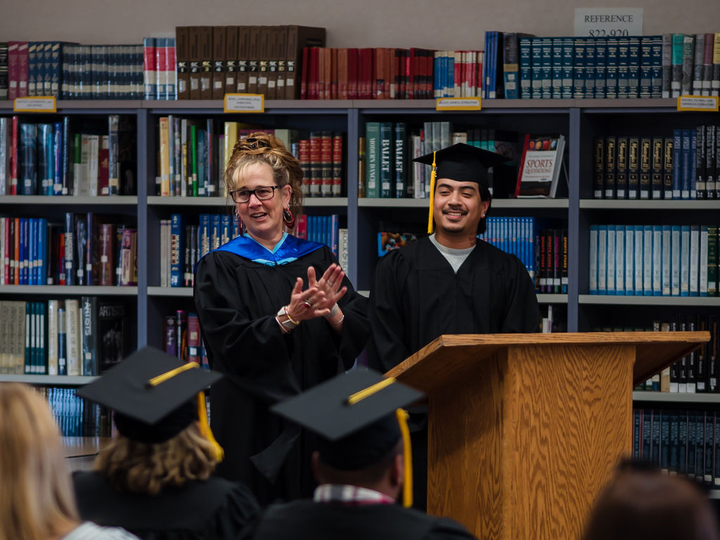 Liz Pulcheon introduces student speaker Salvador Vaca.