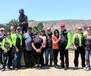 American Legion Chapter 69 members pose next to the Blackhawk statue, a memorial to the 86th Infantry Division, at Camp San Luis Obispo. Photo provided.