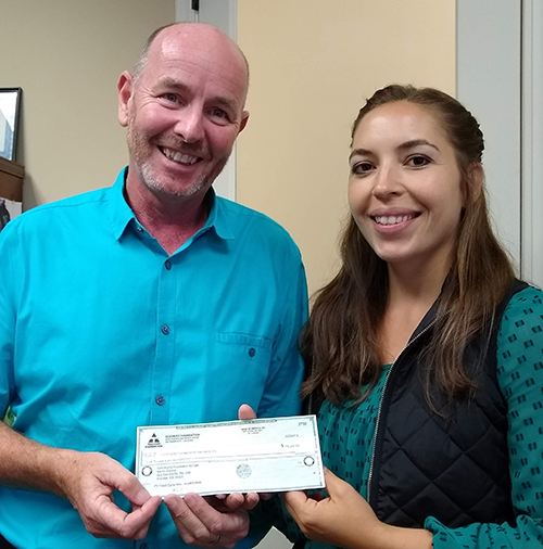 Community Foundation President Gary Byrne and Grants/Projects Manager Salina Chacon receive check from the Teichert Foundation. Photo provided by the Community Foundation for San Benito County.