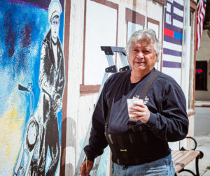 Artist Ronald Rocha works on Whiskey Creek mural. Photo by Heather Graham.