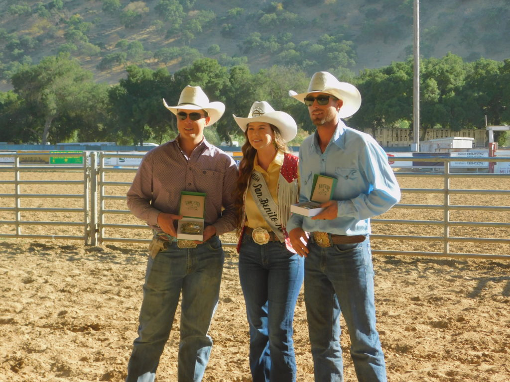 Blane Strohn and Craig Slibsager pose with Miss San Benito Rodeo 2019 Bonnie Mansmith, along with their team roping buckles. Photo by Blaire Strohn.