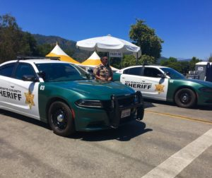 SBC Sheriff deputy Luis Espejo works security at the main entrance to Christmas Hill Park following the Garlic Festival shooting on July 28. Photo courtesy of SBC Sheriff's Office.