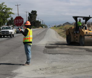 Traffic being rerouted in July 2019 as Graniterock worked to repave a half-mile portion of John Smith Road. A realignment project has been delayed due to mitigation concerns with the California tiger salamander and fairy shrimp habitats. Photo by John Chadwell.