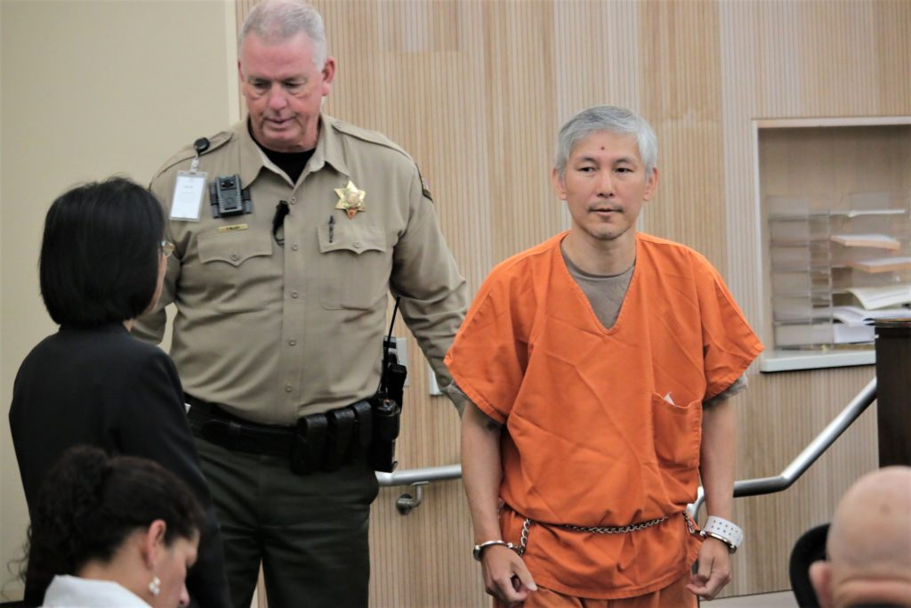 Sang Ji entering the courtroom on July 12. Ji turned down voluntary manslaughter that may have resulted in five-and-a-half years in prison instead of a life sentence. Photo by John Chadwell.