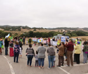 Protesters form a circle before marching toward the San Juan Road overpass at a July 19 demonstration over proposed development along Highway 101. Photo by Noe Magaña.
