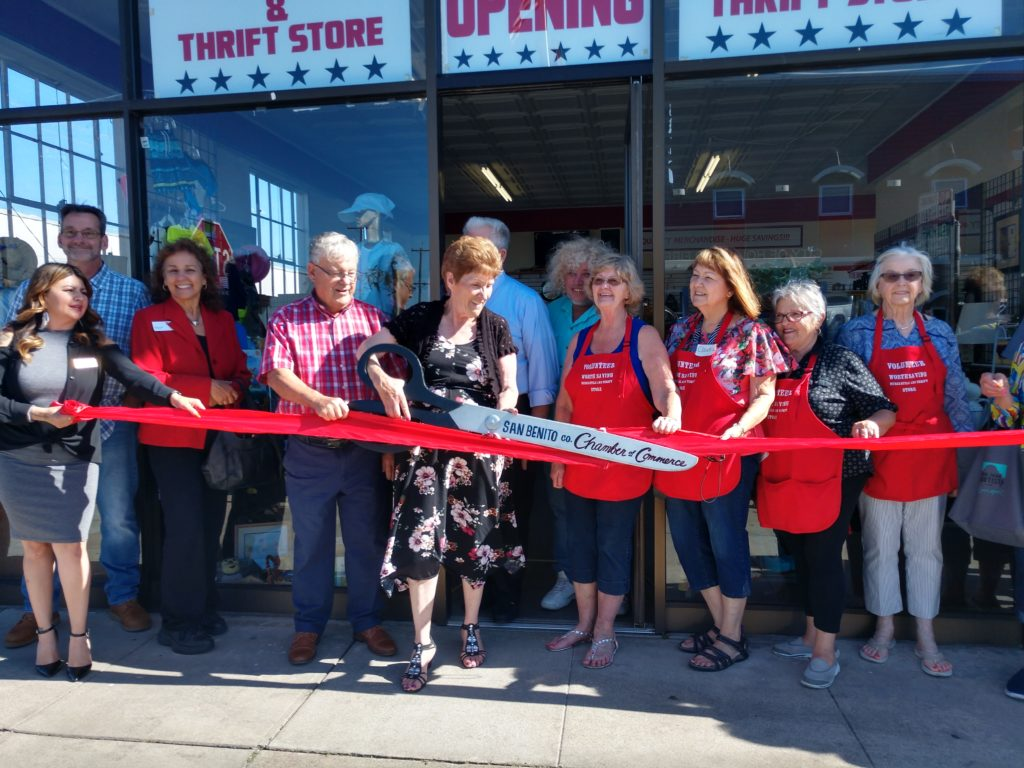 Linda and Pat Lampe cutting the ribbon in front of Worth Saving Thrift Store. Photo by Carmel de Bertaut.
